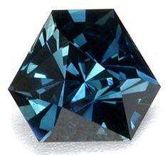 "1.31ct untreated Australian sapphire cut by John Bailey, an unusual ""twisted triangle"" design"