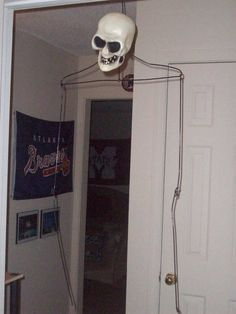 ghost frame?  It's a coat hanger with a plastic skull on it.  Scary?  I think not.