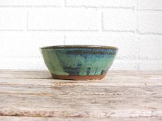 This vintage ceramic bowl was hand made and signed GSR on the bottom. Measures just about 2 tall with a 5 diameter opening. and about 3.5 across at its base. The glazing colors are gorgeous and unique, with beautiful sage green and soft blue strokes. In fantastic condition with no chips