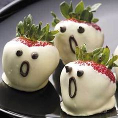 White chocolate covered strawberries with cute little eyes and mouth! Ghost strawberries!