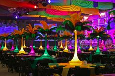 Mardi Gras Theme Ostrich Feather Display - love the color and the draping - center pieces could be difficult for auctioneer to see bidders