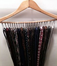This is another clever way to organize your hubby's ties in his closet using a hanger with shower curtain rings