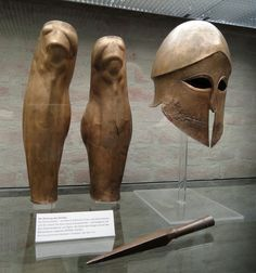 Corinthian helmet & greaves from the tomb of Denda. Made in a Greek workshop in Magna Grecia 500-490 BC.