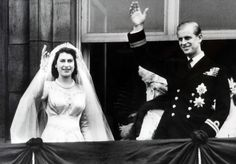 Princess Elizabeth and Prince Philip, Duke of Edinburgh, wave to the crowds from Buckingham Palace on their wedding day, November 20, 1947.