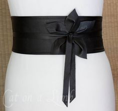 Great tutorial here: http://catonalimb.blogspot.com/2011/12/leather-obi-belt-with-3d-flower.html  I wonder if I could use salvage leather from a leather jacket?