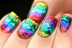 Holy hell that is a LOT of glitter.  I wish I had the patience to do a mani like this.  Wow is that gorgeous.