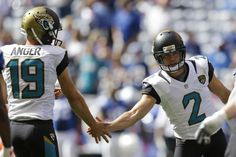 Jacksonville Jaguars' Jason Myers (2) is congratulated by teammate Bryan Anger (19) after kicking a 32-yard field goal during the first half of an NFL football game against the Indianapolis Colts, Sunday, Oct. 4, 2015, in Indianapolis. (AP Photo/Michael Conroy)