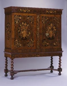 "1690 Dutch Cabinet at the Carnegie Museum of Art, Pittsburgh - From the curators' comments: ""This cabinet is a good example of the international character of cabinet-making at the end of the seventeenth century. While large size and rather square proportions reflect Dutch preferences, the floral marquetry within the framed areas is usually associated with England."""