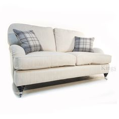 Wade Upholstery Floyd Small Howard Style Sofa in Light Neutral Fabric. Made in Long Eaton Derbyshire by the famous Wade Upholstery Company. Solid beech handwood frame screwed glued and dowelled. Covered in a plain linen style fabric with contrasting grey plaid scatter cushions. In stock for immediate delivery.  Large Sofa 161cm Width x 104cm Depth x 93cm Height. Was £1399 Now £899  For more information call 0115 9258347 or emailinfo@kingsinteriors.com