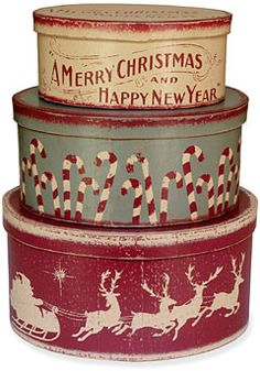 vintage-style christmas boxes Im thinking spray paint and a cricut machine can help with transforming old tins into this!!