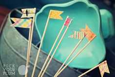 DIY Washi Tape/bamboo skewer flags - would be great as cake/cupcake toppers.  (Washi tape from Pick Your Plum)