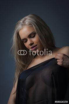 Beautiful young blond wearing black