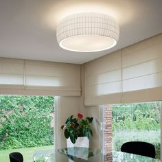 The Isamu Ceiling Light features a white polycarbonate diffuser and a bookbinding tape shade in white, red or black options. http://www.ylighting.com/tango-carpyen-isamu-30-ceiling-light.html #YinTheWild