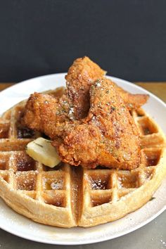Homemade Chicken and Waffles  --  this uncommon combination is drizzled with pure maple syrup and confectioners sugar.