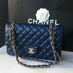 Chanel Medium Classic Double Flap Bag blue caviar leather, silver/gold tone hardware.