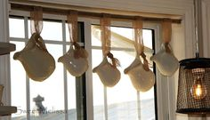 Used an old yardstick & burlap ribbon to hang these pitchers in the window instead of curtains...too cute