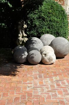 stone sphere collection -  pick them up on the beach! seriously - click on the picture (twice) to see inspirational pictures of how to use beautiful materials