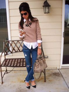 I like the collared shirt, sweater, statement necklace combo.  I would wear with low heeled boots or flats.  No rips in jeans.