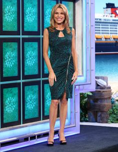 CACHE: Green & black abstract animal print cocktail dress, round neckline, sleeveless, diagonal gold zipper from left waist to hemline | Vanna White's dresses | Wheel of Fortune