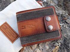 Купить или заказать Кошелек Zenom-Tex в интернет-магазине на Ярмарке Мастеров. Брутальный, такой, кошелек вышел. Прям в руки берешь и понимаешь - ВЕЩЬ. Ткань хлопок с каучуковой пропиткой + кожа вощеная. Фурнитура итальянская. Не толстый и не большой, что позволяет хоть в кармане штанов таскать. Прорезиненная ткань - защищает кошелек от излишней влаги и помогает сохранить форму, в течении долгих лет постоянного пользования... Очень мне он на душу лег. Себе тоже такой сделал.
