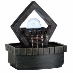 This Ore International indoor meditation fountain is perfect for creating a soothing atmosphere. This indoor fountain features a green earth-tone color, an LED light and glittering crystal.