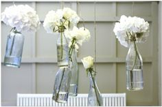 pretty bottled flowers {hang in an outdoor dining area}