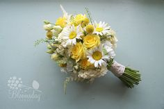 summer bouquet in yellow  yellow roses, craspedia, daisies, astilbe, stock