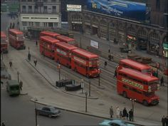 London buses outside Victoria Rail Station, still takem from Turn of the Wheel, London, England, United Kingdom, 1964, photographer unknown.