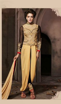 Mesmerize your onlookers at a strike wearing on this beige and black georgette embroidered pant style suit. This beautiful attire is showing some amazing embroidery done with resham and stones work. #EveningWearCollection