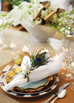 Beautiful peacock place-setting at a Hanukkah table