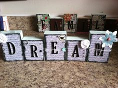 2x4 blocks embellished with scrap book accessories
