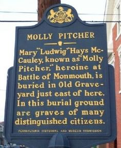 """Molly Pitcher historical marker in Carlisle, PA. Text: Mary """"Ludwig"""" Hays McCauley, known as """"Molly Pitcher,"""" heroine at Battle of Monmouth, is buried in Old Graveyard just east of here. In this burial ground are graves of many distinguished citizens."""