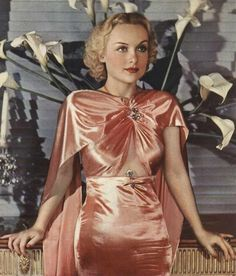 The-power-of-pink---Carole-Lombard in a peach silk dress