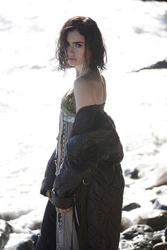 Posing on the beach, Lily Collins wears puffer jacket with embellished slip dress Vera Wang for Malibu Magazine November 2016 Issue