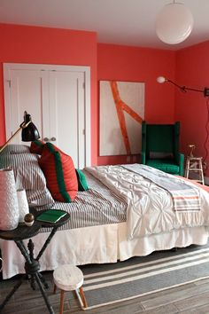 sunset magazine idea house brian paquette bedroom, fire orange walls, west elm bedding, striped sheets
