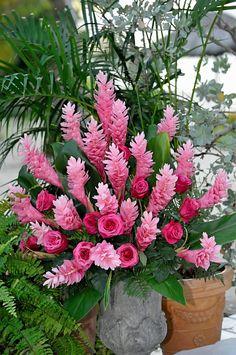 pink floral arrangement; ceremony; tropical flowers; destination wedding; pink ginger; pink roses