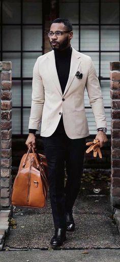 - with a black turtleneck beige blazer black pocket square brown leather duffle bag black pants brown leather gloves brown leather banded watch black shoes Black Turtleneck Outfit, Blazer Outfits Men, Fashion Business, Men In Black, Suit Up, Mens Fashion Suits, Well Dressed Men, Stylish Men, Urban Fashion
