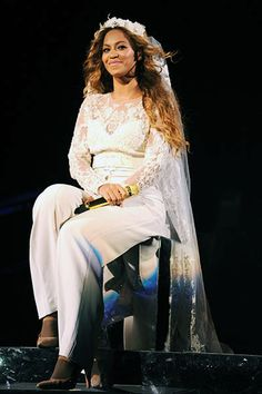 """July 11: Beyonce in a bridal stage costume performs in a wedding look during the """"On The Run Tour: Beyonce And Jay-Z"""" at MetLife Stadium in East Rutherford, New Jersey."""