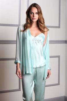 Pyjama set made with luxurious, shimmering Italian silk. Hand finished with embroidered details for a uniquely elegant touch.