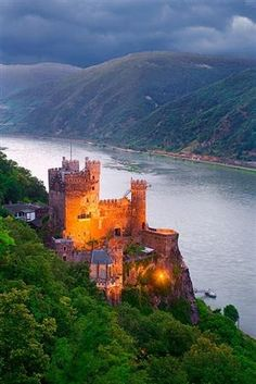 Sunset, Rheinstein Castle, Germany  photo via ursula.  The castle was constructed in about 1316/1317. Rheinstein Castle was important for its strategic location. By 1344, the castle was in decline. By the time of the Palatine War of Succession, the castle was very dilapidated. During the romantic period in the 19th century, Prince Frederick of Prussia (1794–1863) bought the castle and it was rebuilt.