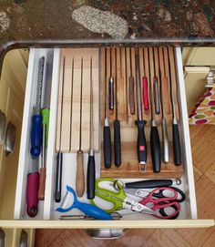 """Susan's two in-drawer knife blocks hog zero counter space. """"My knives last longer, too,"""" she notes  She keeps her sharpening steel here for frequent use """"so I'm less likely to cut myself with a dull knife""""  Empty areas create cubbies for other cutting tools   - GoodHousekeeping.com"""