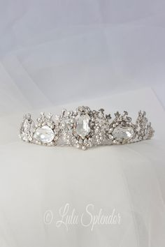 A fabulously decadent and intricate hand made wedding tiara. Features three large Swarovski jewels set into vintage filigrees and further accented
