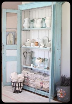 Beautiful Blue Painted Hutch.. would live a small one that would fit underneath the edge of my island!
