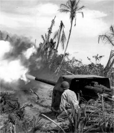 American soldiers firing on the island of Papua, New Guinea