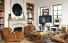 Brad Goldfarb and Alfredo Paredes' East Village duplex. Photo by Miguel Flores-Vianna, produced by Robert Rufino for Architectural Digest April 2012 Architectural Digest, Architectural Features, Easel Tv Stand, Appartement New York, New York City Apartment, Manhattan Apartment, Duplex, East Village, Deco Design