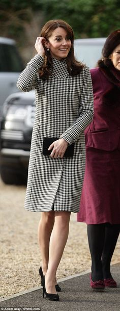 When the Duchess of Cambridge arrived at the centre, she hid her bold dress beneath this Reiss coat, the same one she was seen wearing in Chelsea earlier today