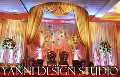gold Indian mandap decoration in chicago with hanging flowers and traditional indian furniture. | Yelp