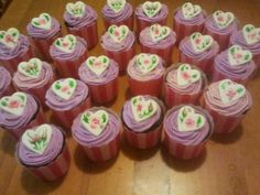 hand painted hearts on purple cupcakes by julie shaw