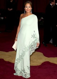 Jennifer Lopez at the 2003 Oscars in Valentino. Pure genius throwback concept. Color is exquisite on her and the jewelry is just perfection.