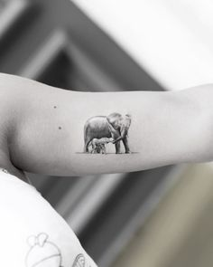 [ Elephant with Cub Tattoo bicep tattoo elephants Baby Tattoos, Family Tattoos, Line Tattoos, Body Art Tattoos, Small Tattoos, Elephant Family Tattoo, Elephant Tattoo Design, Elephant Tattoos, Animal Tattoos